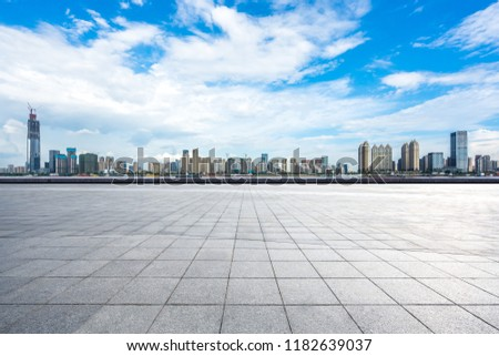 empty square with city skyline in wuhan china #1182639037