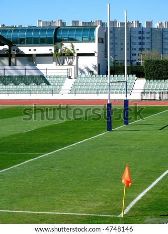 Empty stadium with rugby post - stock photo