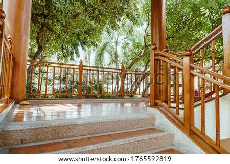 empty stair step with wood banister stock photo