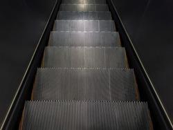 Empty step of escalator going down.