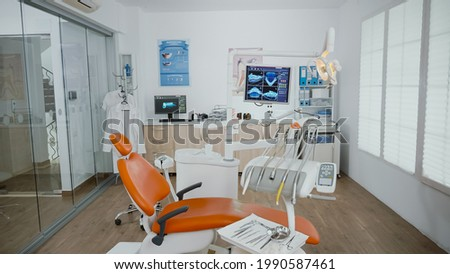 Empty stomatology orthodontist bright office room with nobody in it equipped with professional medical dentistry teeth instruments prepared for dental health surgery. Cabinet ready for tooth surgery Photo stock ©
