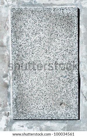 Empty stone plate on a cement wall
