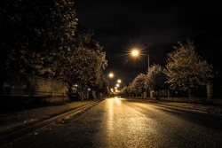 Empty street at night in an estate