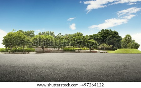Photo of Empty street at the nice and comfortable great garden under lovely blue sky