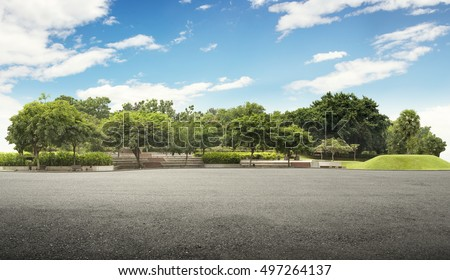 Empty street at the nice and comfortable great garden under lovely blue sky - Shutterstock ID 497264137