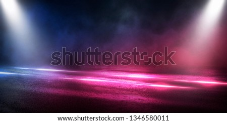 Empty street scene background with abstract spotlights light. Night view of street light reflected on water. Rays through the fog. Smoke, fog, wet asphalt with reflection of lights. Blue and pink neon #1346580011