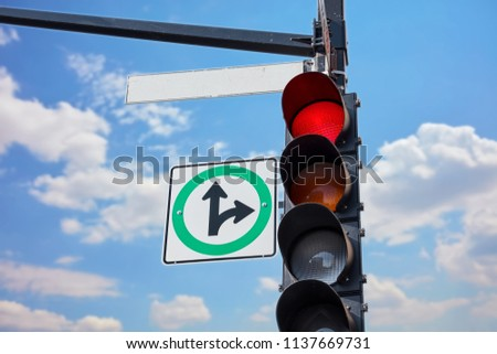 Empty street sign attached to a traffic light signaling red  #1137669731