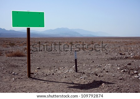empty street sign for message, located in desert