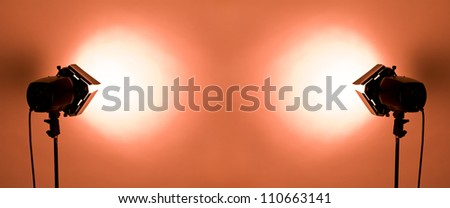 empty studio background and flash lights on light red