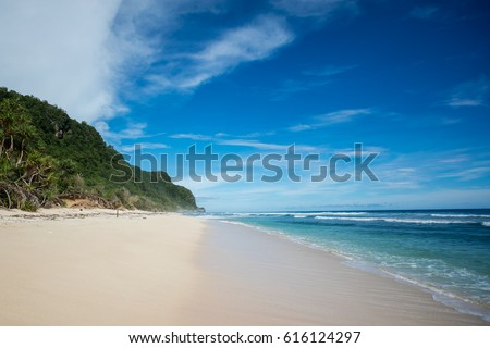 Stock Photo Empty Suluban and Nyang Nyang paradise beach, blue sea waves in Bali island, Indonesia.