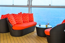 Empty sunbed lounge chairs for relaxing on the open deck of a cruise ship.