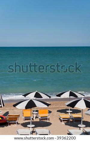 empty sunbeds ready for a good beach vacation