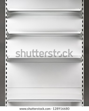 Empty supermarket shelf. Retail store equipment