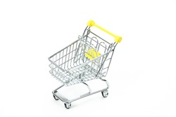 Empty supermarket trolley isolated on white background, rational consumption concept, conscious consumption trend