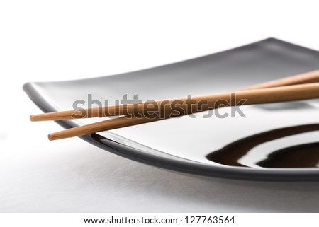 empty sushi set, plateaus and chopsticks isolated on white background