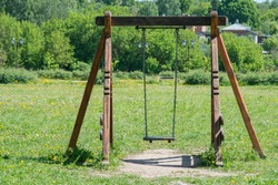Empty swing in the playground. For children funny day from outdoor