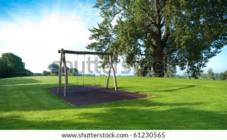 empty swing on a green hill