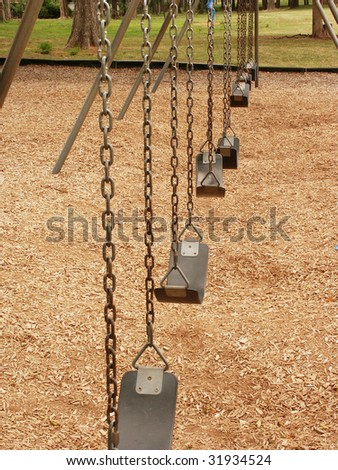 Empty swing sets - stock photo
