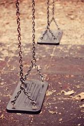 Empty swings on playground