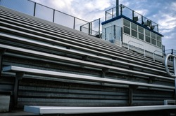 Empty Symmetrical Sports Stadium Metal Bleachers