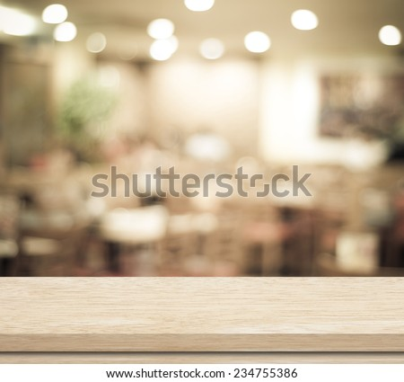 Empty table and blurred restaurant with bokeh background, product display template.