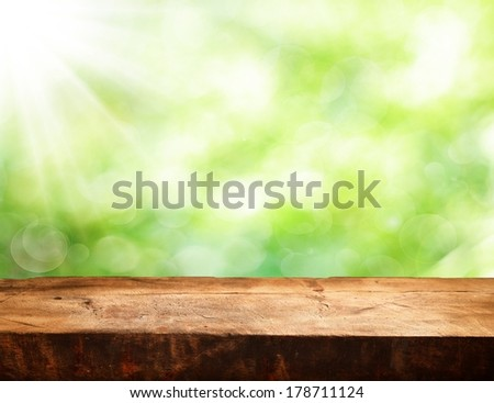 Photo of Empty table and defocused fresh green background