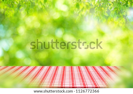 Empty table and picnic on abstract background for Your photomontage or product display.