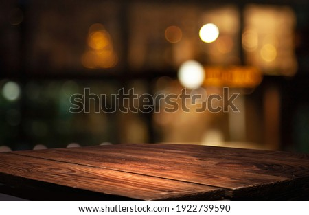 empty table to showcase your product, against the background of a blurred cafe golden bokeh