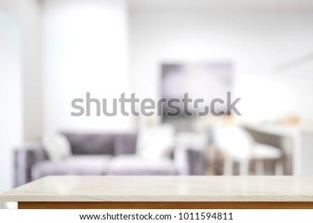 Empty table top in living room interior background. For product display montage.