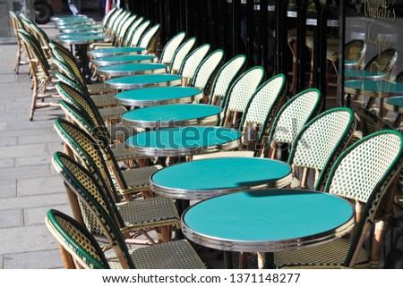 empty tables at a Parisian street cafe, france #1371148277