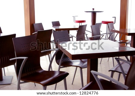 Empty tables in a closed modern coffee shop