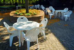 Empty tables of outdoor cafe in the fall