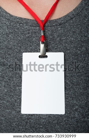 Empty tag ID on gray clothing background. Empty id card mock up. Vertically.
