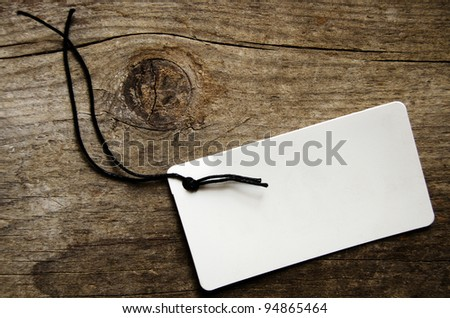 Empty tag over a wooden background