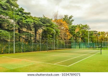 Empty tennis court at El Retiro historic gaden park, Madrid city, Spain - Shutterstock ID 1034789071
