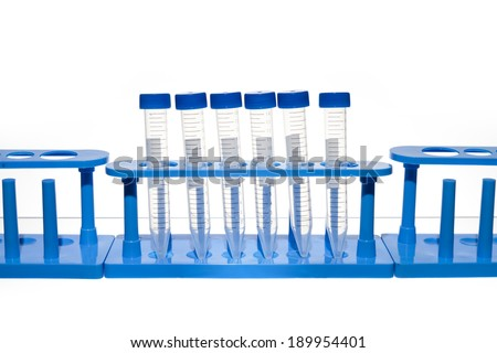 Empty Test Tubes in a Rack. Test tubes in test tube holders against a white background.