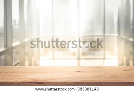 Empty the top of wood table with  blur  sunlight in window building.background.for product display and presentation