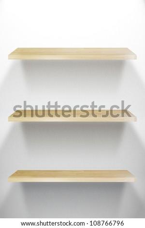 Empty three wood Shelf on white wall