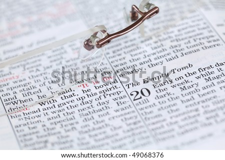 Empty tomb - Open Bible with selective focus on the text in John 20 about Jesus\' resurrection. Shallow DOF
