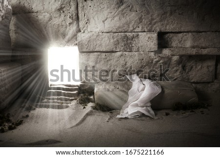 Empty tomb while light shines from the outside. Jesus Christ Resurrection. Christian Easter concept.