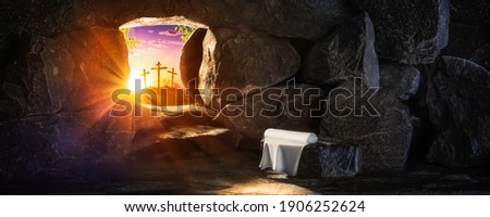 Empty Tomb With Linen Cloth At Sunrise With Sunlight Shining Through  The Open Door And Three Crosses In The Distance  - Crucifixion And Resurrection Concept ストックフォト ©
