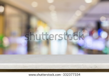 Empty top of natural stone table and blur with bokeh background. For product display