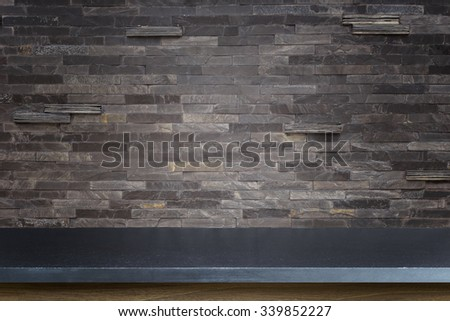 Empty top of natural stone table and stone wall background. For product display #339852227