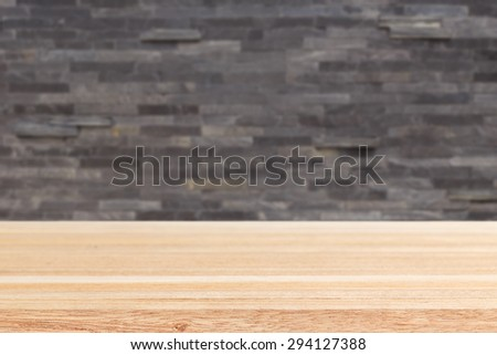 Empty top of wooden table or counter and black slat wall background