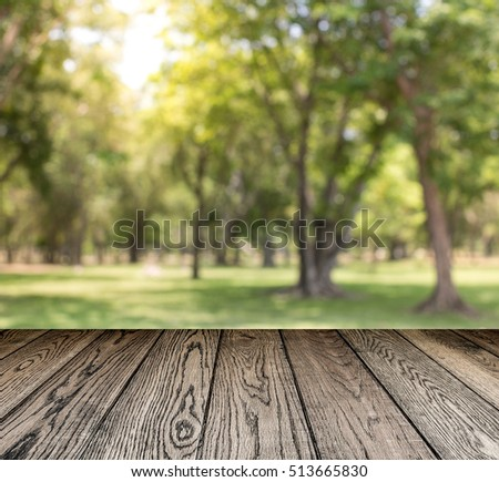 Empty top of wooden table or counter and view of landscape background. For product display #513665830