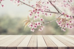 Empty top wooden table and flower blurred background. Can use for product display