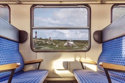 empty train compartment with view on quaint landscape through window