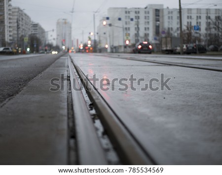 empty tram rails in the background of the city #785534569