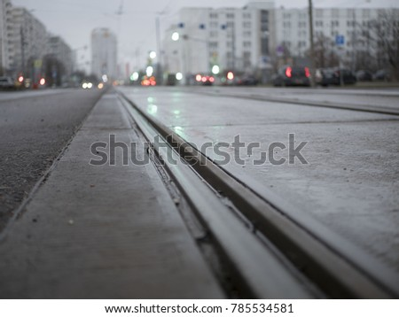 empty tram rails in the background of the city #785534581