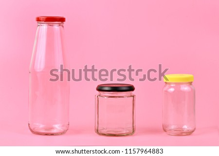 Empty transparent bottle isolated on pink background #1157964883